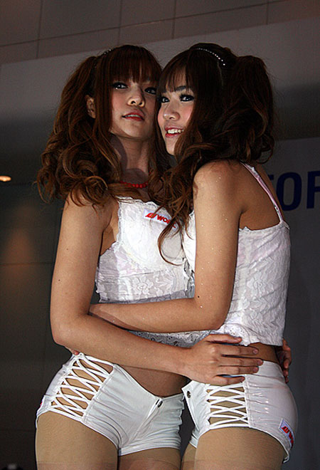 Hot Asian booth babes hugging