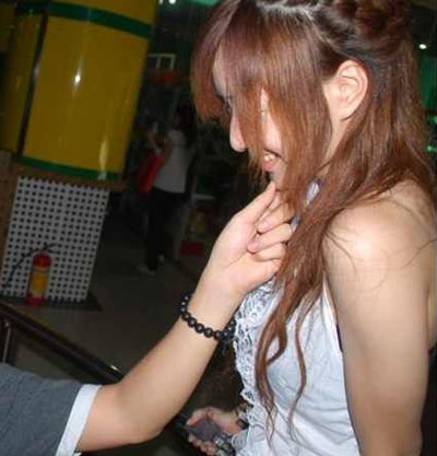 Internet cafe hostess flirts with customer